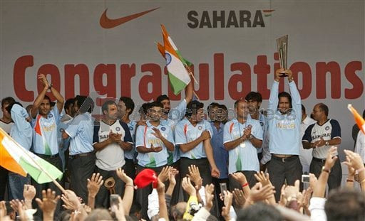 Indian cricket Twenty 20(T20) team members greet the crowd at the felicitation ceremony.