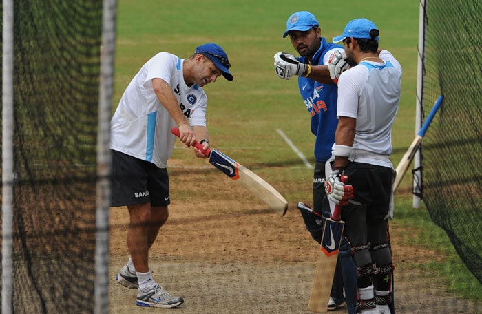 Indian cricket coach Gary Kirsten (L) gives batting tips to players Murali Vijay (C) and Virat Kohli (R).(AFP Photo)