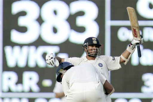 """Sachin Tendulkar and Yuvraj Singh celebrate India's victory during the fifth day of the first Test match between India and England in Chennai on Monday, December 15, 2008. The Little Master dedicated his 41st Test century that powered India's sensational victory against England on Monday to Mumbaikars recovering after the terror attacks and provided the balm hoping his ton will give """"some happiness to them.""""<br><br>Tendulkar, with his 103 not out, his fifth Test hundred at Chepauk, has equalled the feats of Mohammad Azharuddin (5 at Eden Gardens, Kolkata) and Sunil Gavaskar (5 at Wankhede Stadium, Mumbai). They share the Indian record for most hundreds (5) at one venue. (AP Photo)"""
