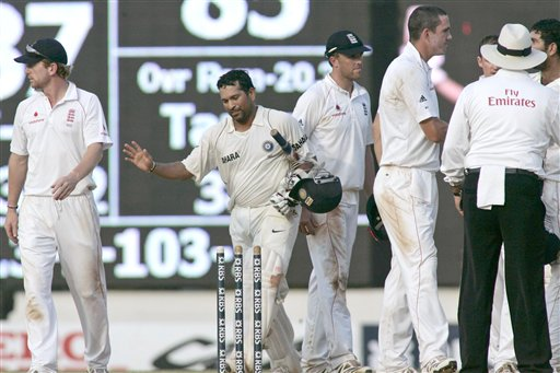 England team cricketers shake hands as Sachin Tendulkar walks to take a stump as a souvenir during the fifth day of the first Test cricket match between India and England in Chennai on Monday, December 15, 2008. (AP Photo)