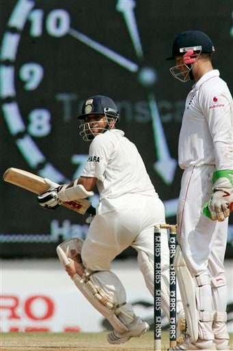Sachin Tendulkar, left, takes a run as Matt Prior looks on during the fifth day of the first Test cricket match between India and England in Chennai on Monday, December 15, 2008. (AP Photo)