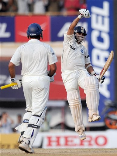 Sachin Tendulkar celebrates scoring a 100 runs and winning the match on the fifth day of the first cricket Test match against in Chennai on Monday December 15, 2008. (AP Photo)