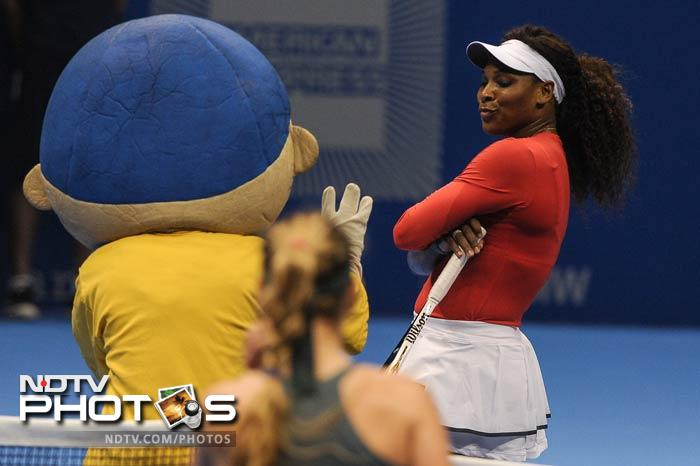 While Wozniacki was impersonating Serena, the American player was having fun herself. She is seen here sharing a light moment with the mascot.
