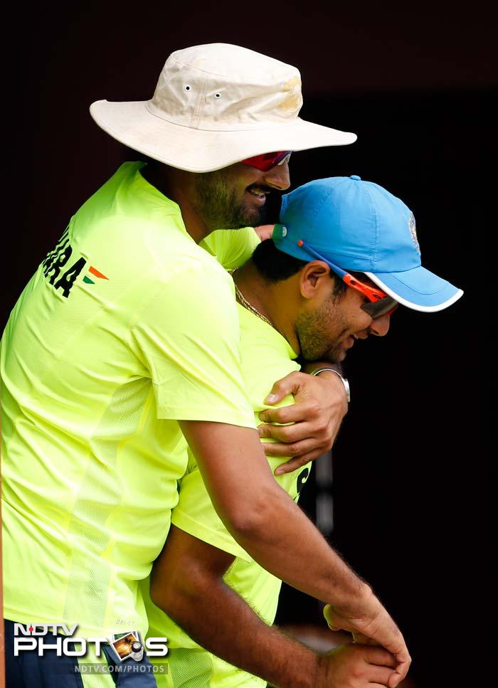 R Ashwin (not in pic) may have cemented his place in the playing XI but the other two spinners in Harbhajan (left) and Piyush Chawla are not letting their shoulders droop.<br><br> The two 'wrestle' each other here!