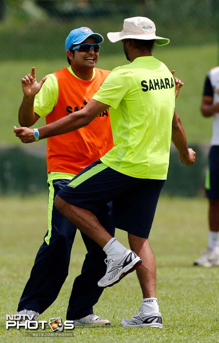 Suresh Raina (left) and Harbhajan Singh dance during the practice session in Colombo.