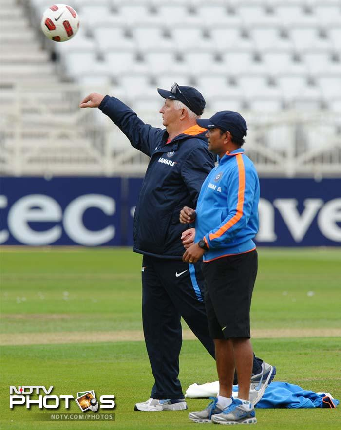 India's coach Duncan Fletcher (L) throws a football during the practice session.