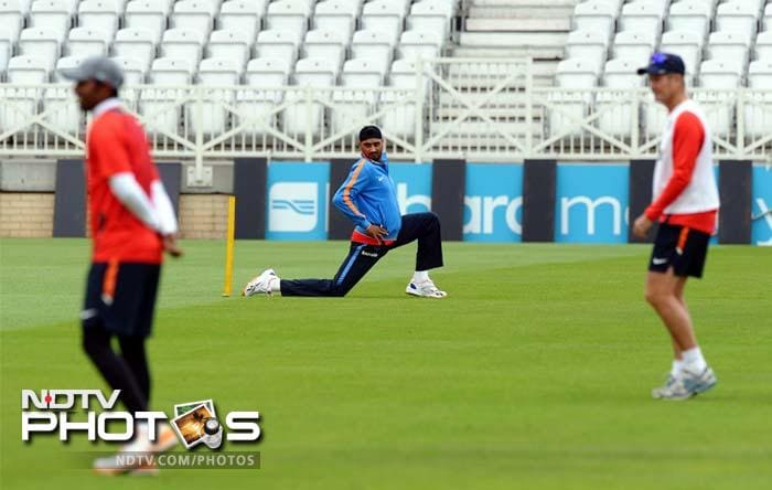 India's Harbhajan Singh (C) stretches before bowling in the nets during the practice session.