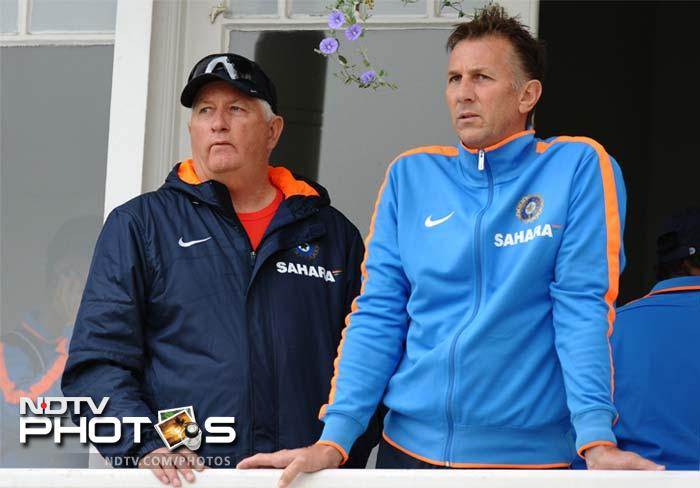 Indian coach Duncan Fletcher (L) watches from the balcony as the team sweats it out at Trent Bridge in Nottingham.
