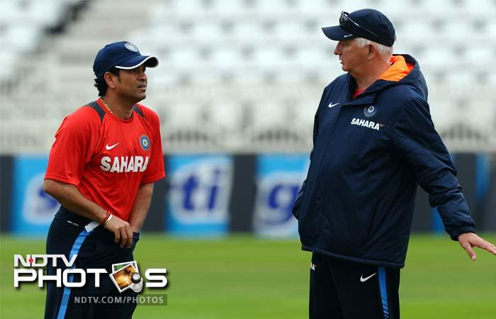India's Sachin Tendulkar (L) talks to coach Duncan Fletcher during the practice session. The two had a lot to talk about.