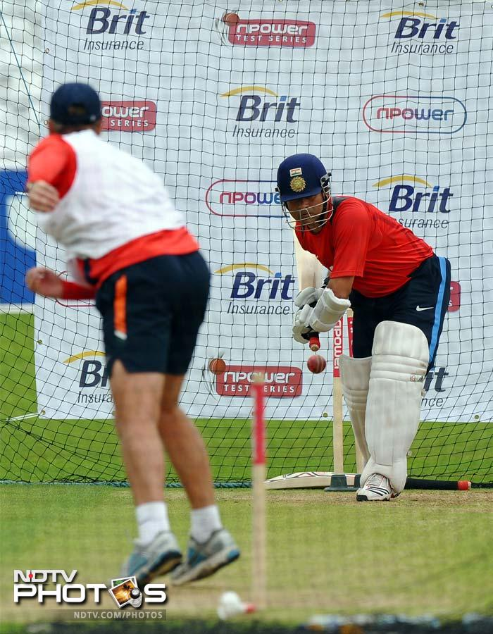 India's Sachin Tendulkar (R) gets down to business, practicing his batting during the training session.