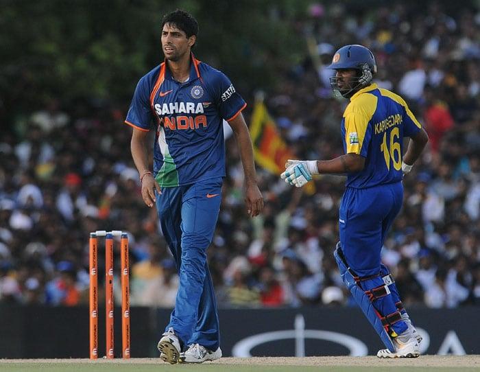 Ashish Nehra celebrates after he dismissed Chamara Kapugedera during the final ODI of the Micromax tri-series between Sri Lanka and India in Dambulla. (AFP Photo)