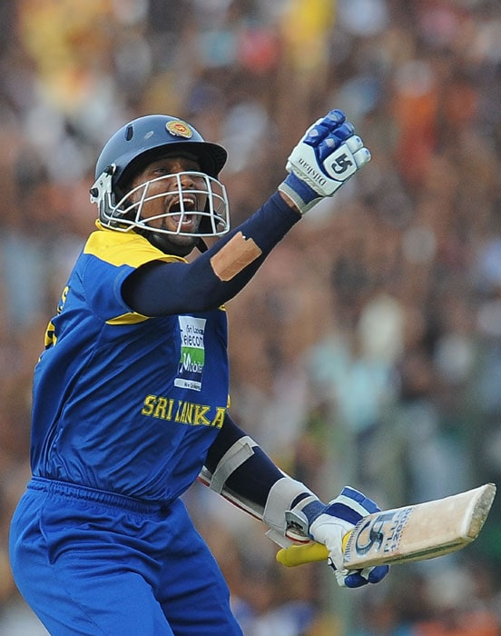 Tillakaratne Dilshan celebrates after scoring a century (100 runs) during the final ODI of the Micromax tri-series between Sri Lanka and India in Dambulla. (AFP Photo)