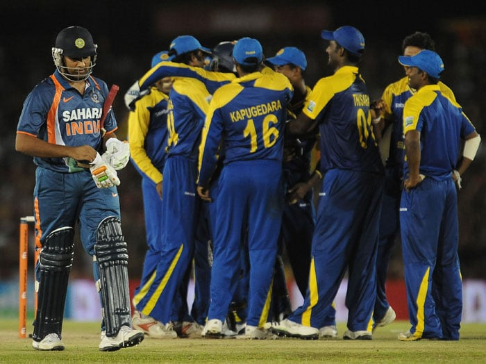 Rohit Sharma walks back to the pavilion after his dismissal during the final ODI of the Micromax tri-series between Sri Lanka and India in Dambulla. (AFP Photo)