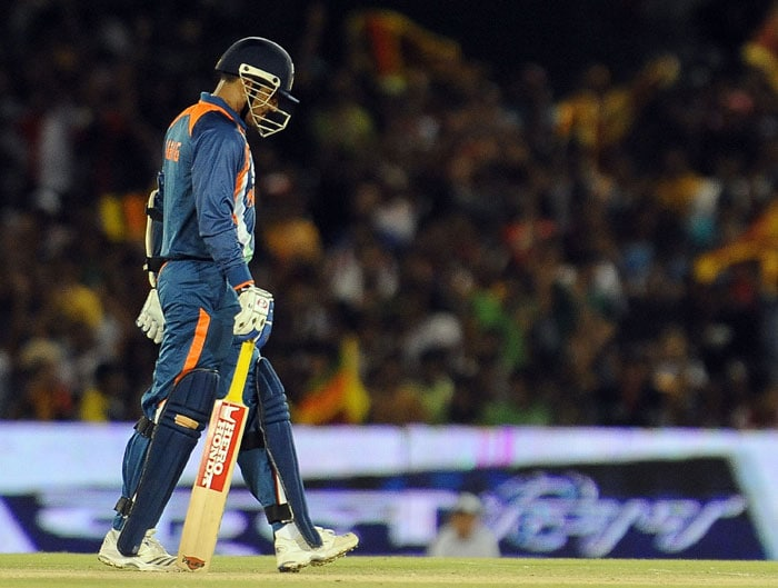 Virender Sehwag walks back to the pavilion after his dismissal during the final ODI of the Micromax tri-series between Sri Lanka and India in Dambulla. (AFP Photo)