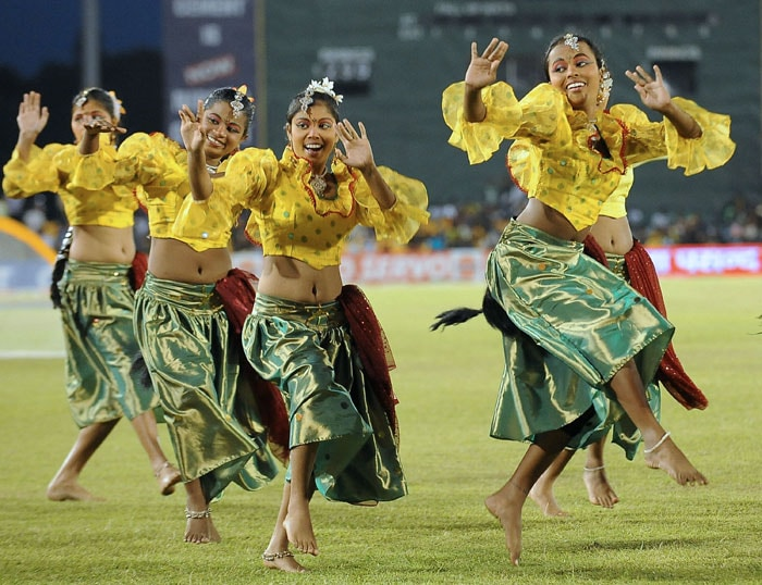 Sri Lankan artists perform traditional dance during a break in the final ODI of the Micromax tri-series between Sri Lanka and India in Dambulla. (AFP Photo)