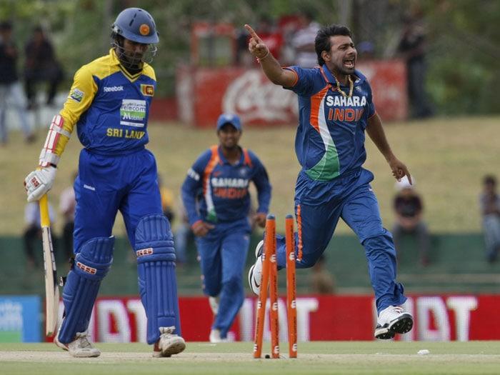 Praveen Kumar celebrates the dismissal of Upul Tharanga during the third ODI of the Micromax tri-series between Sri Lanka and India in Dambulla. (AP Photo)
