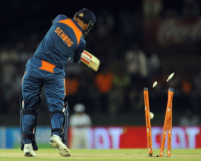 Virender Sehwag is bowled on a free hit delivery by Lasith Malinga during the third ODI of the Micromax tri-series between Sri Lanka and India in Dambulla. (AFP Photo)