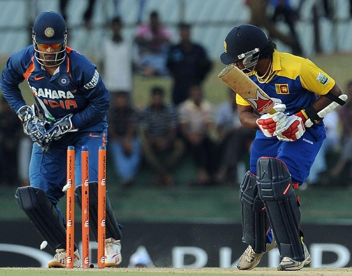 Mahendra Singh Dhoni successfully stumps Lasith Malinga during the third ODI of the Micromax tri-series between Sri Lanka and India in Dambulla. (AFP Photo)