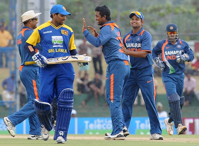 Pragyan Ojha celebrates with his teammates after the dismissal of Tillakaratne Dilshan during the third ODI of the Micromax tri-series between Sri Lanka and India in Dambulla. (AFP Photo)