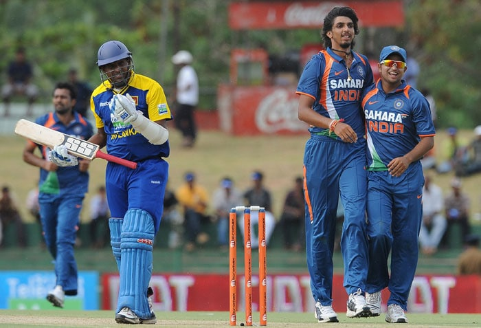 Ishant Sharma celebrates with teammate Suresh Raina after the dismissal of Thilan Samaraweera during the third ODI of the Micromax tri-series between Sri Lanka and India in Dambulla. (AFP Photo)