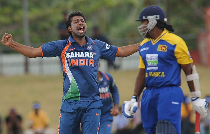 Praveen Kumar celebrates after he dismissed Mahela Jayawardene during the third ODI of the Micromax tri-series between Sri Lanka and India in Dambulla. (AFP Photo)