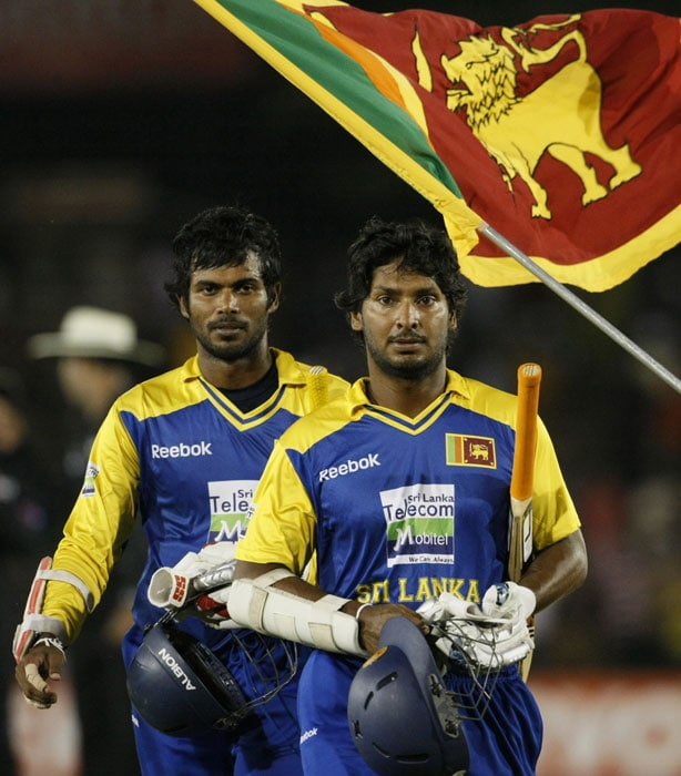 Sri Lankan captain Kumar Sangakkara and Upul Tharanga leave the ground after Sri Lanka defeated India by 8 wickets during the 5th ODI of the tri-series in Dambulla. (AP Photo)