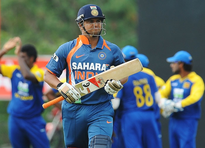 Suresh Raina walks back to the pavilion after his dismissal during the 5th ODI of the tri-series in Dambulla. (AFP Photo)