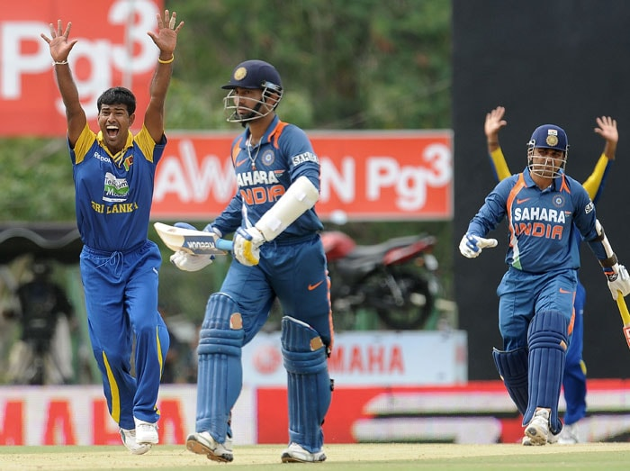 Nuwan Kulasekera successfully appeals for a LBW decision against Virender Sehwag during the 5th ODI of the tri-series in Dambulla. (AFP Photo)