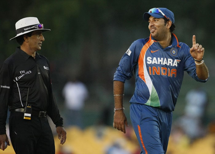 Yuvraj Singh shares a light moment with Pakistani umpire Azad Rauf during the 5th ODI of the tri-series in Dambulla. (AP Photo)