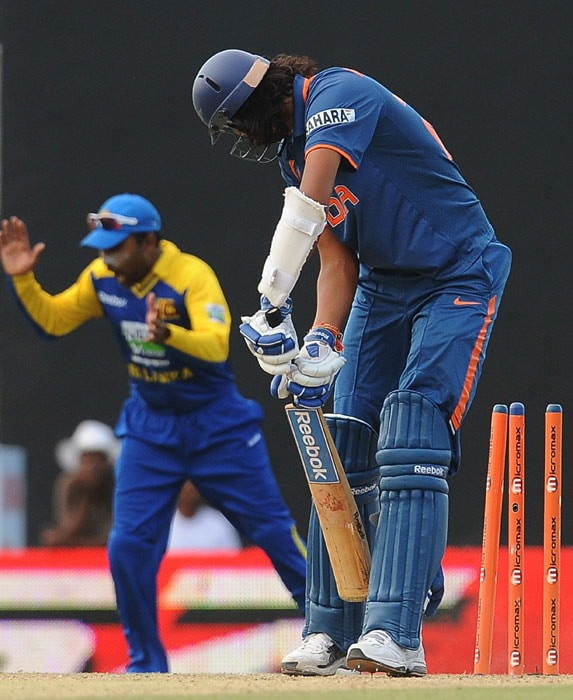 Ishant Sharma is dismissed by Thissara Perera during the 5th ODI of the tri-series in Dambulla. (AFP Photo)