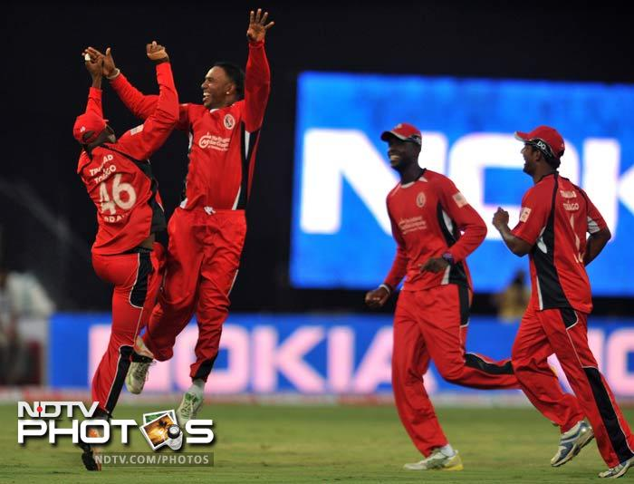 It was, however, Trinidad spinner Samuel Badree who started the wicket fall, getting 2 wickets at the cost of just 7 runs in his 4 overs. (AFP Photo)