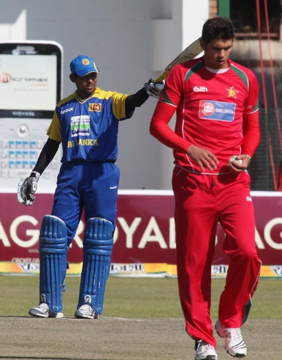 Sri Lankan skipper Tillakaratne Dilshan gestures after reaching his century in the final of the tri-series against Zimbabwe at the Harare Sports Club. (AP Photo)