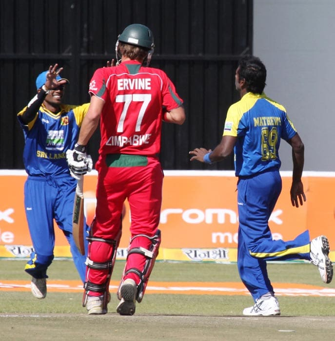 Sri Lankan players celebrate after Zimbabwean batsman Craig Ervine is run out in the final of the tri-series at the Harare Sports Club. (AP Photo)