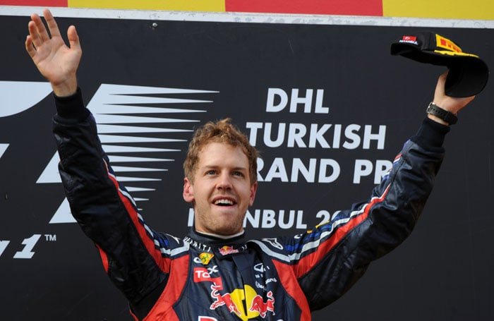 Red Bull Racing's German driver Sebastian Vettel celebrates on the podium at Istanbul Park after winning the Turkish Formula One Grand Prix, his 3rd victory in 4 races. (AFP PHOTO)