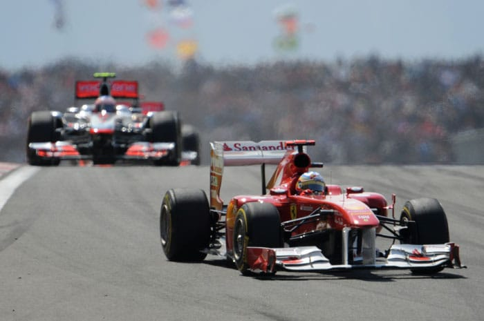 Ferrari's Spanish driver Fernando Alonso (R), who came in 3rd and McLaren Mercedes' British driver Lewis Hamilton in 4th, drive at Istanbul Park during the Turkish Formula One Grand Prix. (AFP PHOTO)