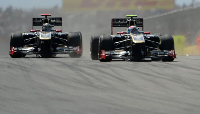 Lotus Renault GP drivers Nick Heidfeld (L) and Vitaly Petrov (R) did well to finish 7th and 8th respectively at Istanbul Park in the Turkish Formula One Grand Prix. (AFP PHOTO)