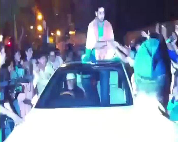 Amitabh and Son Abhishek took to the streets to celebrate India's victory.