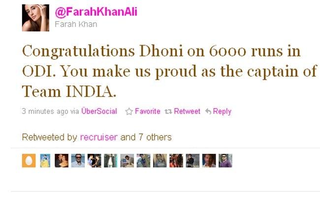 Farah congratulates Dhoni.
