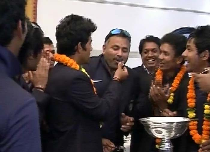The players looked jubilant and the trophy was for all to see here.