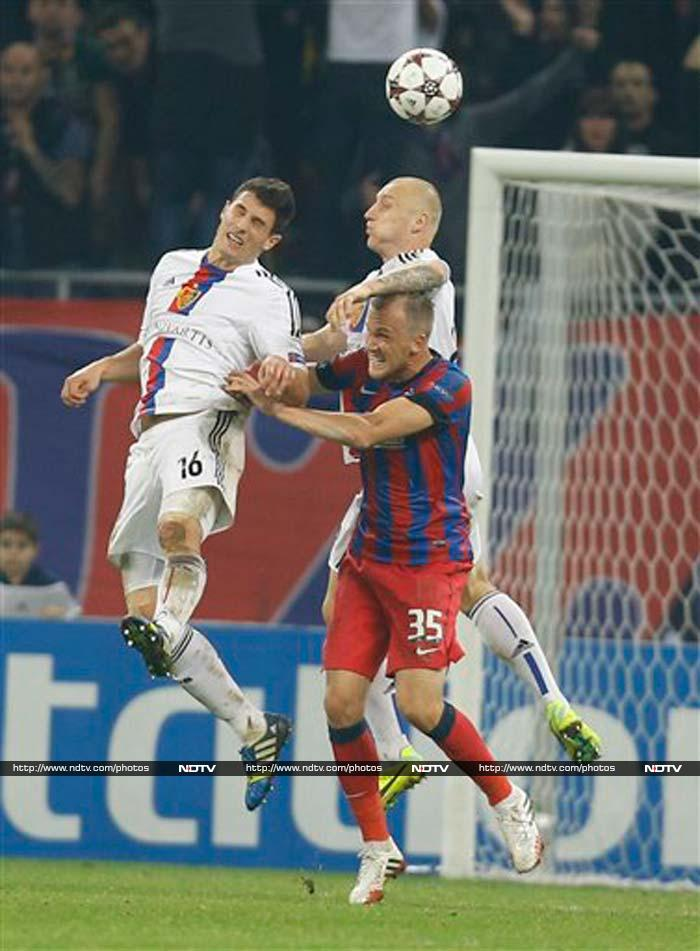 A late equalizer from Leondro Tatu gave Steaua Bucharest a 1-1 draw against Basel and its first point in Group E of the Champions League on Tuesday.
