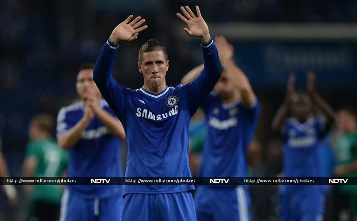 Fernando Torres marked his 100th start for Chelsea with a brace in a 3-0 win away to Schalke on Tuesday as Jose Mourinho's side safely negotiated a tough test in Champions League Group E.