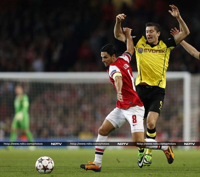 Robert Lewandowski (right) ruined Arsene Wenger's birthday as the Borussia Dortmund striker's late goal clinched a 2-1 win against Arsenal in the Champions League on Tuesday. (All AP and AFP images)