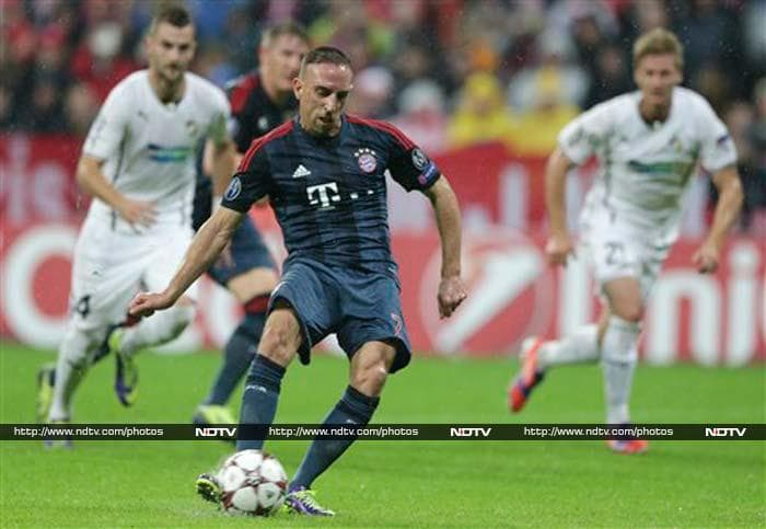 Franck Ribery scored twice as defending champion Bayern Munich thrashed Viktoria Plzen 5-0 on Wednesday to take a big step toward the Champions League knockout stage.