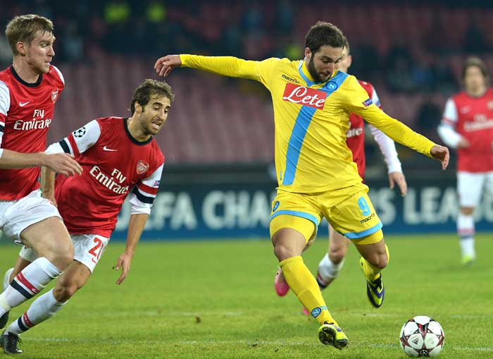 Napoli beat 10-man Arsenal 2-0 in their final Champions League Group F game, as the Gunners qualified in second place following a late victory for Borussia Dortmund away to Marseille.