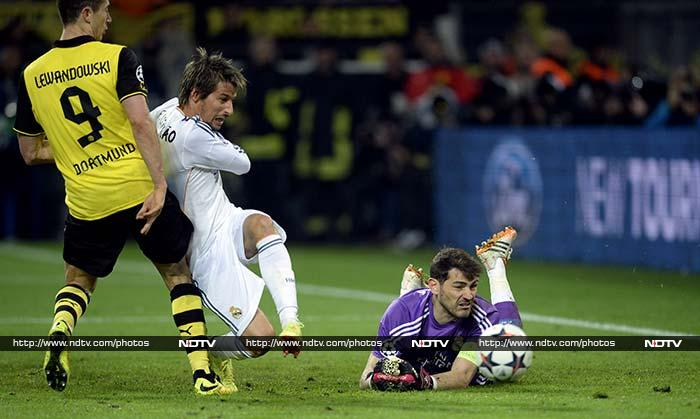 Captain Iker Casillas said Real Madrid were given a Champions League wake-up call as they lost 2-0 to last season's beaten finalists Borussia Dortmund in their quarter-final second leg match but still went through to the last four 3-2 on aggregate.