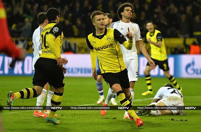 Borussia Dortmund exited the Champions League with their heads held high, beating Real Madrid 2-0 in Tuesday's quarter-final second leg but losing the tie 3-2 on aggregate. After Real's Angel Di Maria had an early penalty saved, Marco Reus breathed life into Borussia's semi-final dreams with two goals in an electric opening 45 minutes.