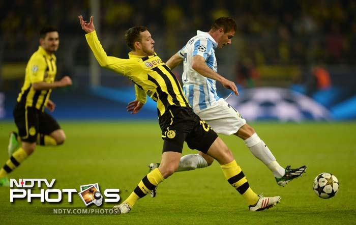 Joaquin put Malaga ahead in the 25th minute to put the pressure immiediately on hosts Borussia Dortmund.