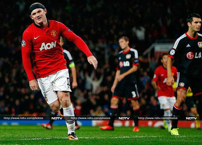 Wayne Rooney reached 200 Manchester United goals with a brace to give David Moyes a 4-2 win over Bayer Leverkusen in his first Champions League group game on Tuesday. <br> The striker scored a brace while Robin van Persie netted a brilliant volley and Antonio Valencia got the fourth one. Simon Rolfes and Omer Toprak scored for Bayer Leverkusen.