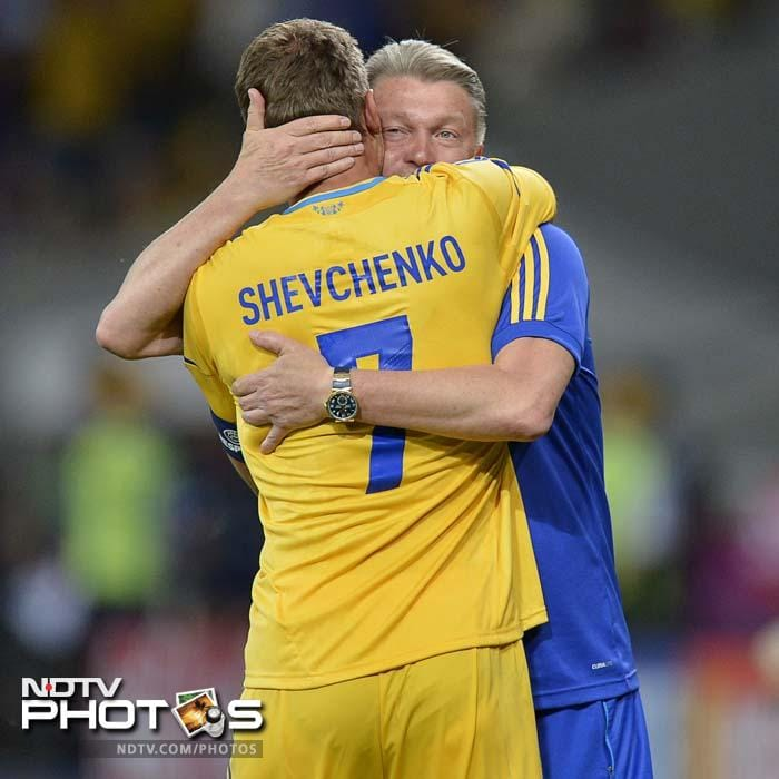 From one legend to another: Ukraine's star player embraced by Ukraine coach and football great Oleg Blokhin.