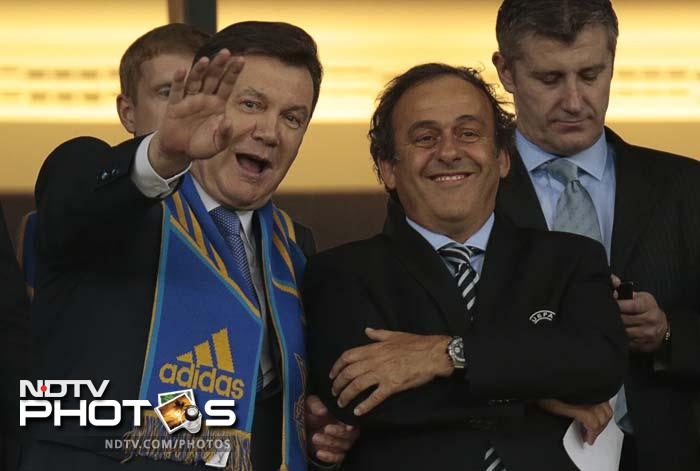 Ukrainian President Viktor Yanukovych, left, waves as he watches with UEFA President Michel Platini the Group D match between Ukraine and Sweden.